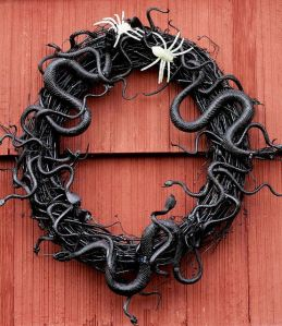 Wreath + hot glue + snakes + spray paint = Perfect, scary wreath