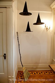 Broom? Check. Three witch hats? Check. Some string to hang them from? DONE! Perfect for the entryway or a Halloween photo booth