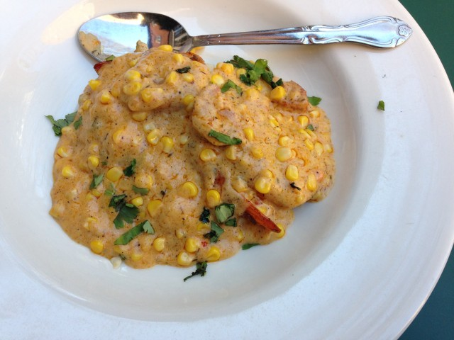 Shrimp and grits with corn and andouille maque choux