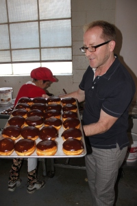 Ta-da! Top Pot co-founder Mark shares his fresh chocolate, creme-filled doughnuts
