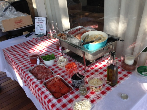 Backyard pizza party toppings bar
