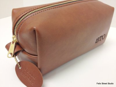 This make-up/whiskey/miscellaneous leather bag is nice...