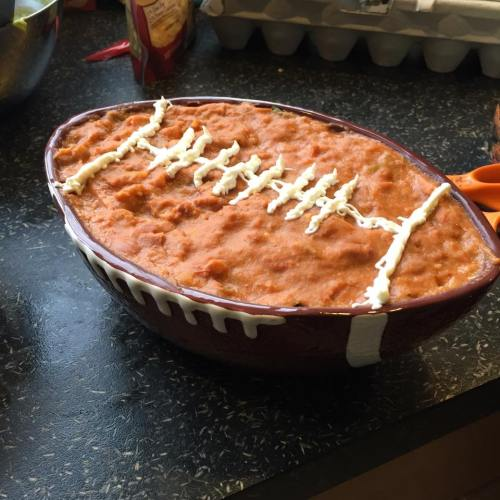 Football bean dip with sour cream laces!