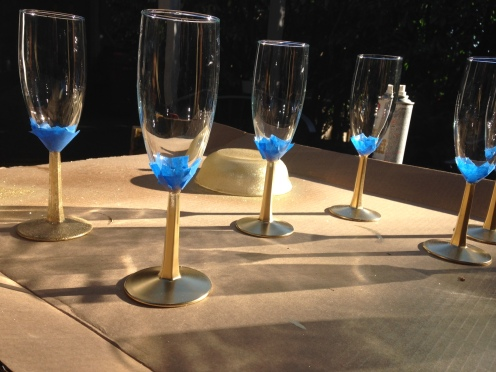 Half painted golden champagne glasses