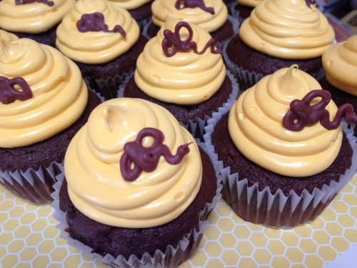 Handmade chocolate bees on cupcakes