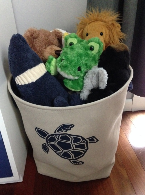 "A close up of the ""zoo"" bin for Michael's stuffed animals."