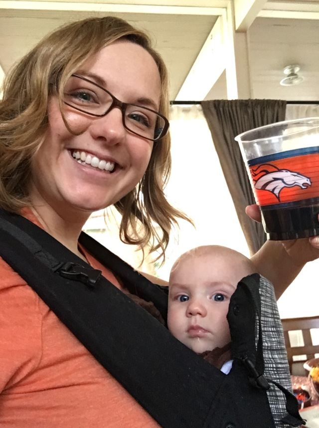 How I watched the game: wearing a wee one, with a {plastic} glass of wine.