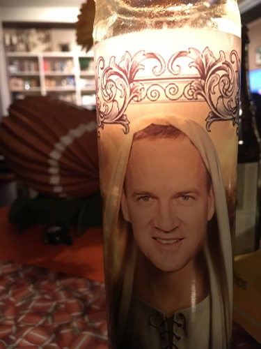 Our Peyton Manning prayer candle. Worked spectacularly this year!