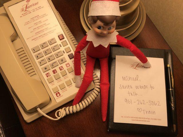 Elf on the Shelf calling Santa